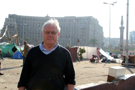 Standing in Tahrir Square, Cario_ Note burned out government building behind Brian